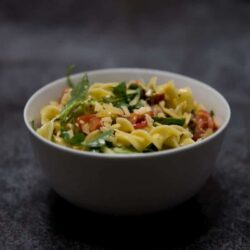 Broad noodles with arugula, tomatoes, and Parmesan: The taste of Italy